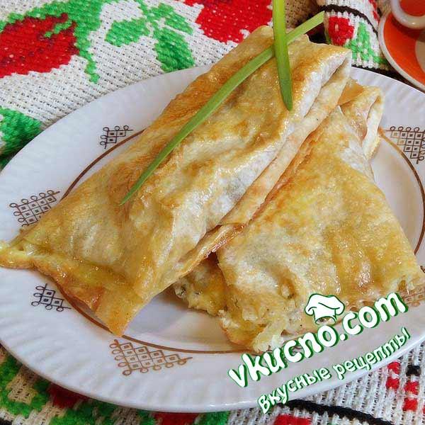 Закуска из лаваша с начинкой из сыра в духовке